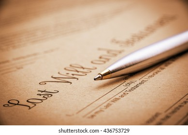 Vintage / retro style : Blue ballpoint pen on a last will and testament. A blank / empty form printed on a light brown mulberry paper and waiting to be completed and signed by testator or testatrix.