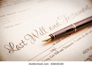 Vintage / retro style : Fountain pen and a last will and testament. A form is printed on a light brown mulberry paper and waiting to be completed / signed by testator or testatrix.