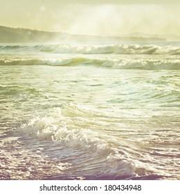 Vintage retro stylized photo of ocean waves