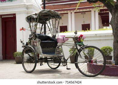Vintage retro tricycle bike or rickshaw of thai style at front of gate of Wat Songtham Worawihan in Samut Prakan, Thailand