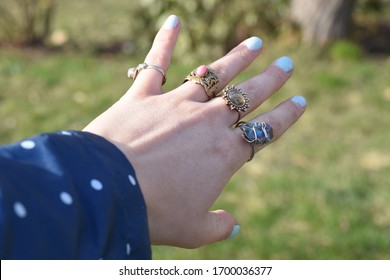 Vintage rings on a hand of a young woman