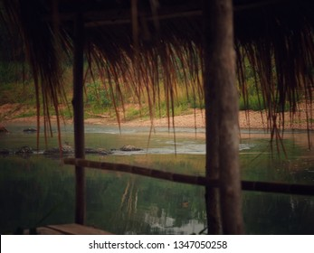 vintage river in the morning. The eaves near river image. Eaves built from grass.