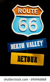 Vintage road sign Route 66 close up isolated on black background