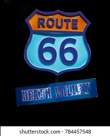 Vintage road sign Route 66 Death Valley isolated on black background. 3d illustration