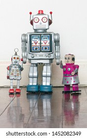 vintage robot toys famiily on old wooden floor