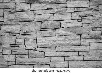 Vintage rock brick sandstone wall texture.