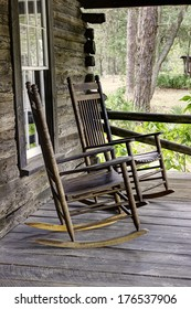 Vintage Rocking Chairs on the porch of a wooden cabin
