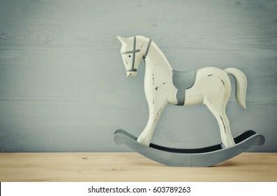 vintage rocking horse on wooden floor.