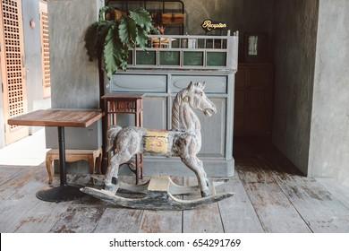 Vintage Rocking hourse in vintage house. Old rustic toy
