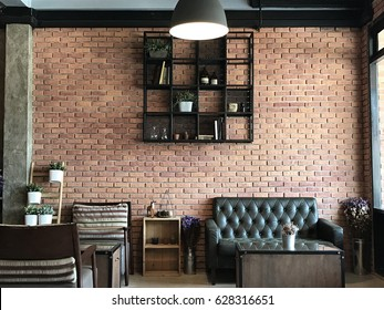 Vintage room with sofa set brick wall background, in the cafe.