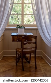 Vintage room with table and chair in front of the window in old rural house