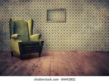 Vintage room with wallpaper and old fashioned armchair. Rustic interior design.