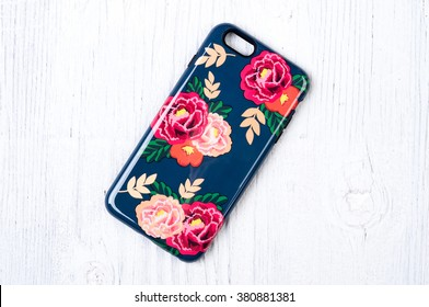 Vintage rose pattern protective case for smart phone on white wooden background