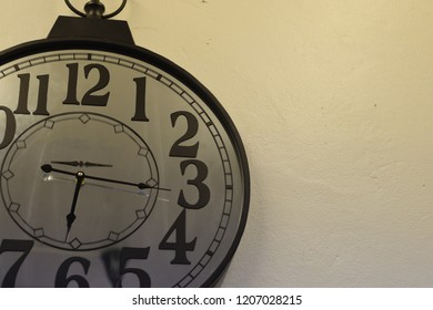 Vintage round clock face on background.
