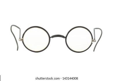 Vintage round eyeglasses isolated on white.