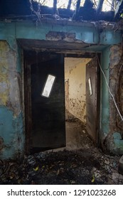 Vintage rubber swinging doors at an abandoned and derelict lunatic asylum/hospital (now demolished), Cane Hill, Coulsdon, Surrey, England, UK