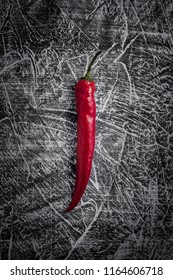 Vintage rustic background with chilli peper. Toned picture