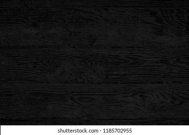 Vintage rustic black wood texture of old pine planks. Cool black background with wood pattern.