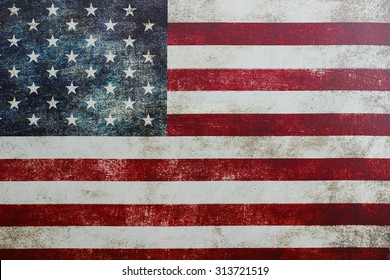 Vintage rustic red, white and blue American flag on canvas; Memorial Day, 4th of July holiday background with copy space