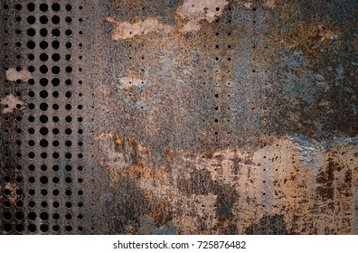 The vintage rusty grunge steel decorated by drilling a wall textured background. Wall steel rust resistant nature. - Shutterstock ID 725876482