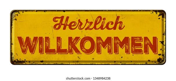Vintage rusty metal sign - German for Welcome - Herzlich willkommen