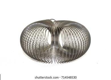 Vintage Rusty Metal Slinky toy on White Background