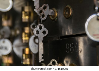 The vintage safety deposit box and key.