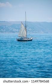 Vintage sailing boat at sea in Cornwall