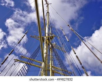Vintage sailing ship mast and rigging. Traditional nautical transportation.