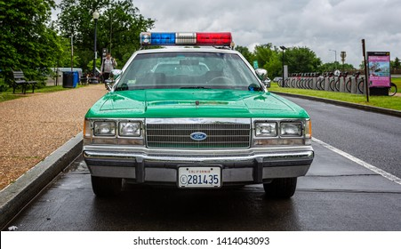 Vintage San Diego California Highway Patrol police car parked outside The Jefferson memorial in Washington, DC, USA on 13 May 2019