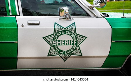 Vintage San Diego California Sheriff insignia on side of Highway Patrol police car parked outside The Jefferson memorial in Washington, DC, USA on 13 May 2019