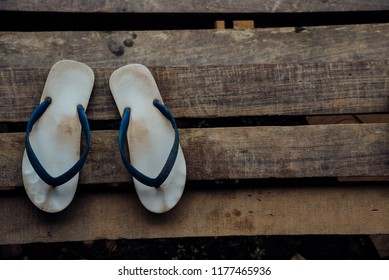 58c5b9d5c072 Vintage sandal or thongs or flip-flop blue color is a footwear on wooden  staircase