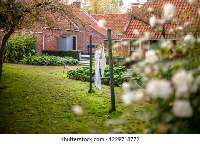 Vintage scene in an old farmers' and fishermen's village in the Netherlands with a backyard and home craft