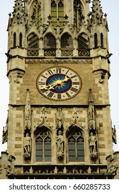 Vintage scene of Rathaus tower wih clock in Munich, Germany.