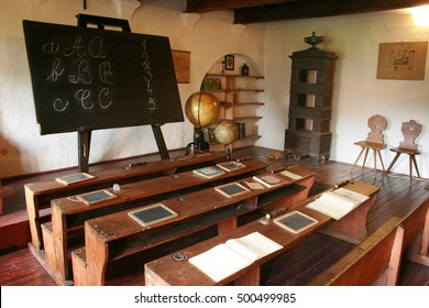 Vintage school class with typical wooden benches