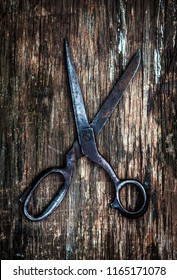 Vintage Scissors on the Wooden Background closeup