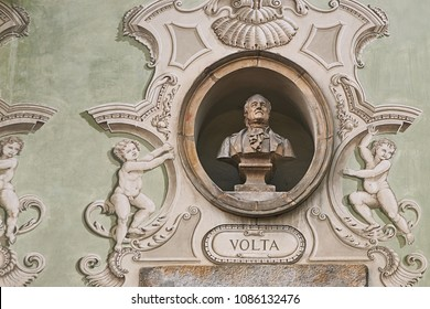 Vintage sculpture portrait of Alessandro Volta, an Italian physicist, chemist, and a pioneer of electricity and power on a facade of an old building in Bellinzona, Switzerland