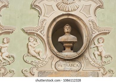 Vintage sculpture portrait of Francesco Petrarca, a scholar and poet of Renaissance Italy on a facade of an old building in Bellinzona, Switzerland