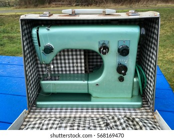 Vintage sewing machine with checker patterned case