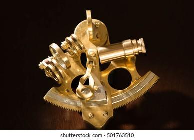Vintage sextant on black background