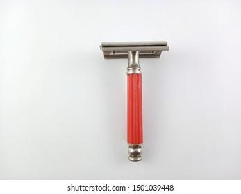 vintage shaving beard tool.vintage razor isolated white background