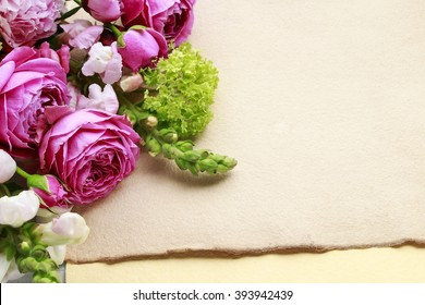 Vintage sheets of paper and bouquet of flowers, copy space. Blank space for greetings.