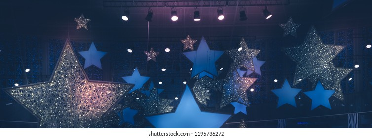 Vintage shining stars shape spotlights soffits night show stage performance background with gradient dark blue pink lilac purple lights