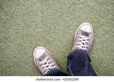 vintage shoes on carpet grass