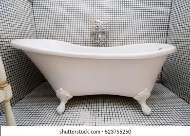 Vintage shower bath tub in colonial interior style bathroom