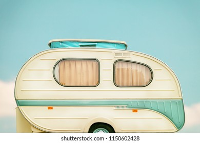 Vintage side of a caravan in two tone green and white