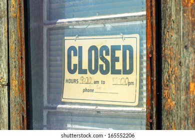 Vintage sign 'Closed' on the old wooden door