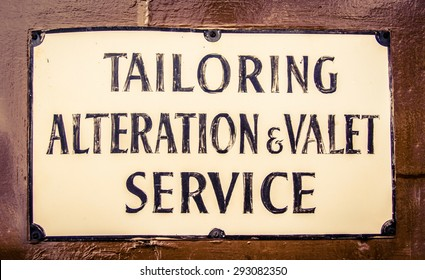 A Vintage Sign For A Tailor And Valet In London England