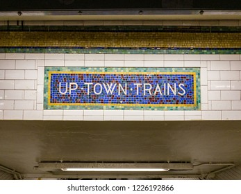 Vintage sign for uptown trains made of mosaic tiles.