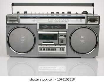 Vintage silver boom box on white background with reflection